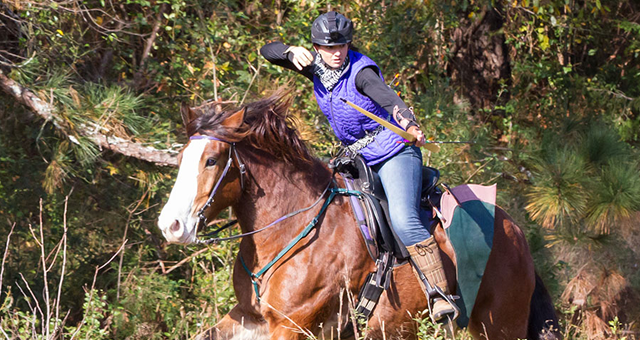 Kim & Tadpole navigating the cross-country hunt course at the 2017 Horseback Field Archery Championships.